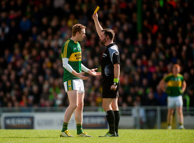 Colm Cooper is yellow-carded by referee David Gough. Photo: Sportsfile