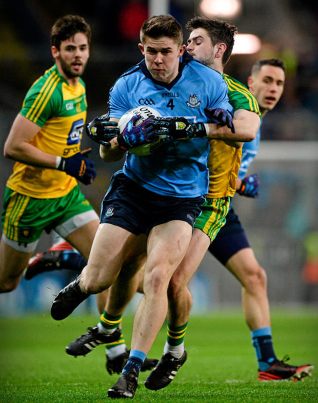 Dublin's David Byrne is tackled by Donegal's Ryan McHugh during their NFL Division 1 match at Croke Park. Photo: Dáire Brennan/Sportsfile