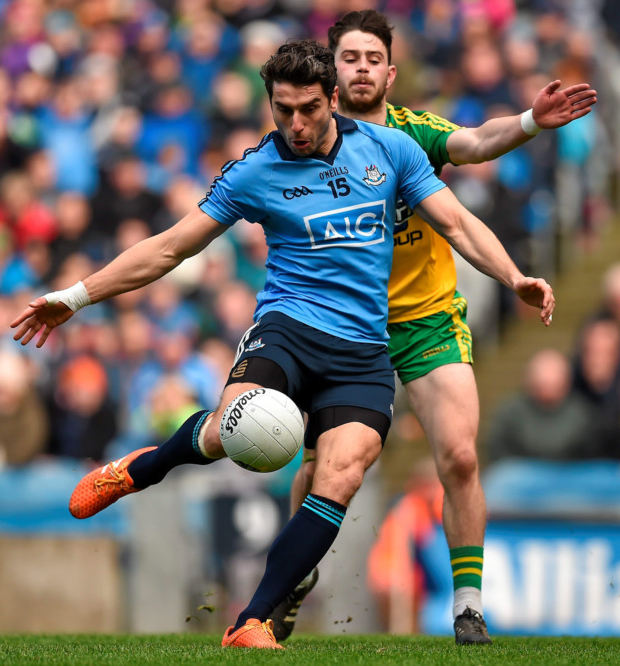 Dublin's Bernard Brogan gets his shot away as Donegal's Ryan McHugh closes in during the Allianz FL Division 1 semi-final Photo: Sportsfile
