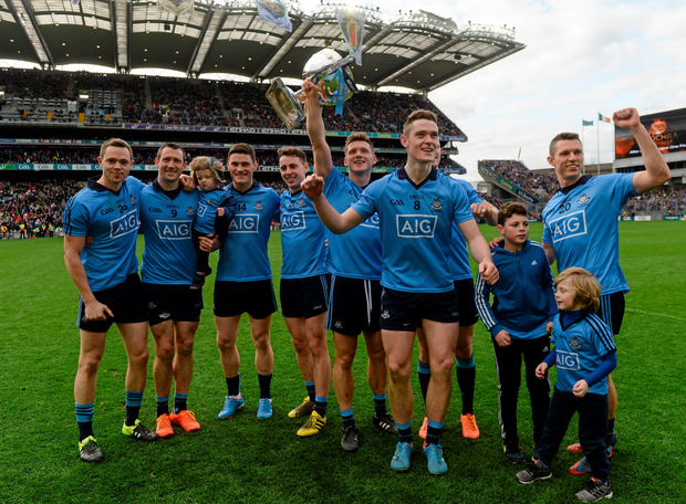 The Dublin team celebrates with the League trophy Photo: Sportsfile