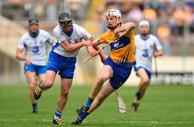 Pauric Mahony (left) in action against Clare's Conor Cleary. Photo: Sportsfile