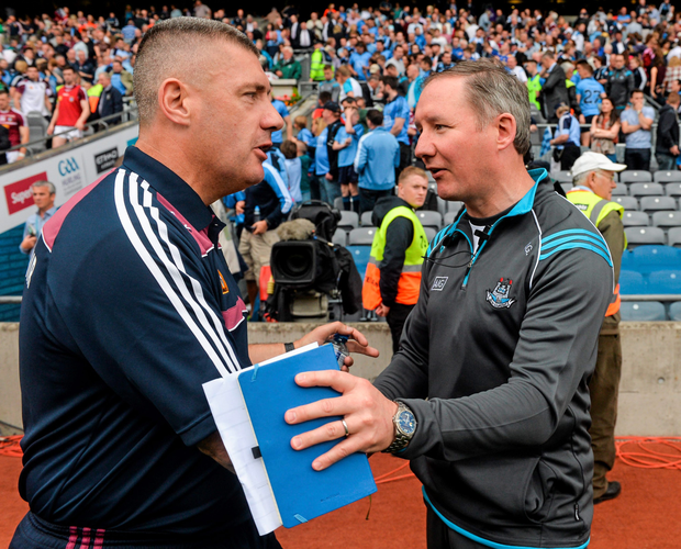 Dublin manager Jim Gavin (right) shakes hands with Westmeath boss Tom Cribbin after the game.