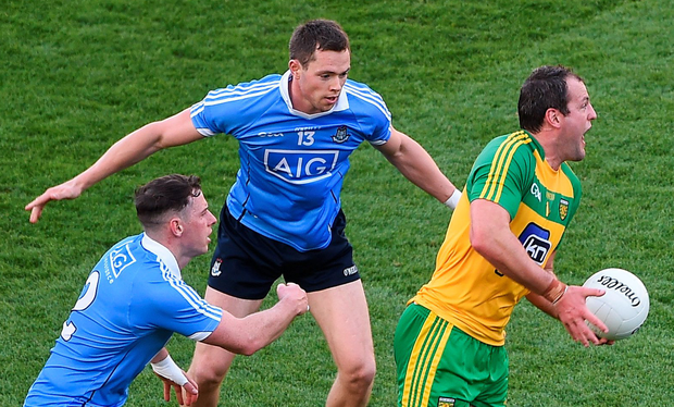 Michael Murphy of Donegal in action against Philly McMahon (left) and Dean Rock of Dublin Picture: Sportsfile