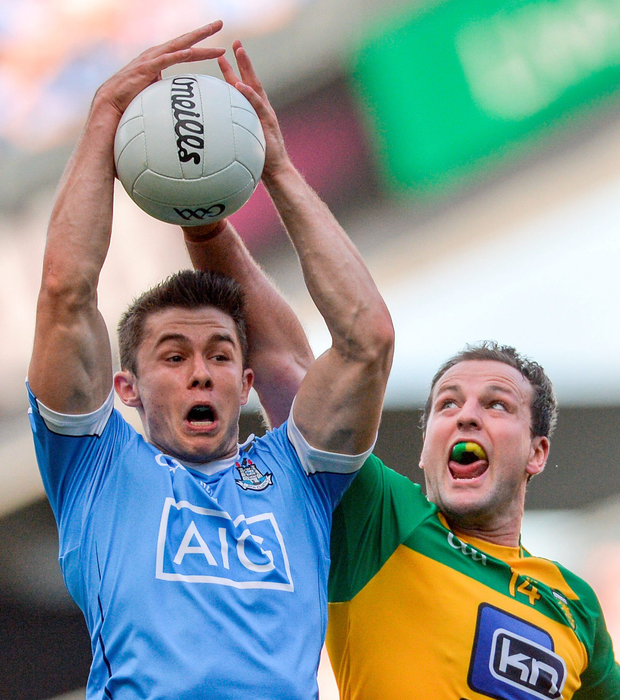 Dublin's David Byrne wins possession ahead of Donegal's Michael Murphy. Pic: Sportsfile