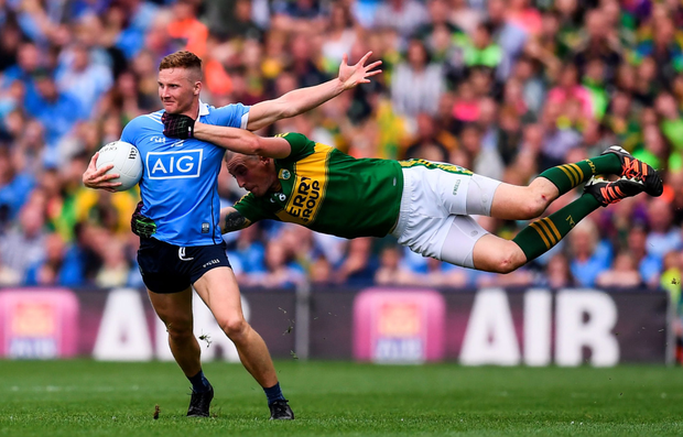 Ciarán Kilkenny of Dublin is tackled by Kieran Donaghy of Kerry at Corke Park yesterday. Photo: Sportsfile