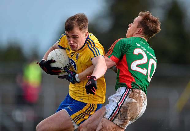 Donal Vaughan in action against Enda Smith of Roscommon Photo: Sportsfile