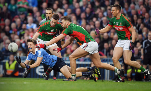 Dublin's Michael Fitzsimons keeps the ball away from Mayo's Diarmuid O'Connor and Aidan O'Shea (r) in the All-Ireland SFC final replay. Photo: Sportsfile