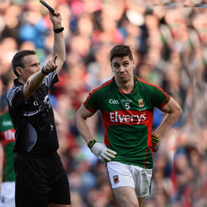 Ref Maurice Deegan issues Mayo's Lee Keegan with a black card in the All-Ireland SFC final replay. Pic: Sportsfile