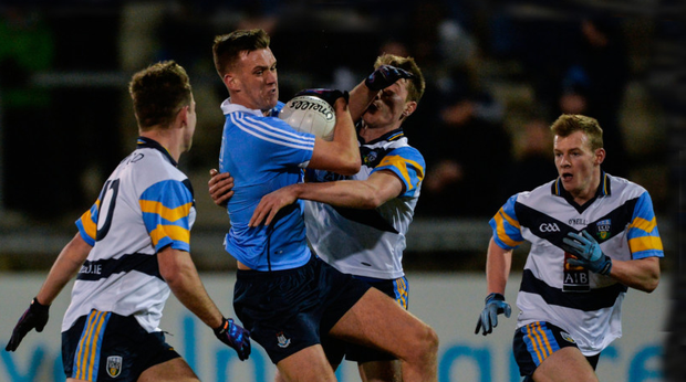 Dublin's Ryan Deegan tries to break through the tackle of UCD's Niall McInerney during last night's Bord na Móna O'Byrne Cup clash at Parnell Park. Pic: Sportsfile