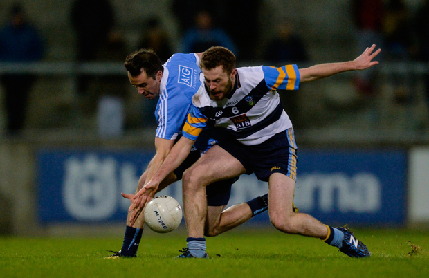 Dublin's Gary Sweeney and UCD's Jack McCaffrey battle for possession last night. Pic: Sportsfile