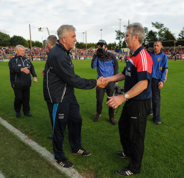 Rival managers, Dublin's Ger Cunnnigham and Cork's Kieran Kingston. Pics: Sportsfile
