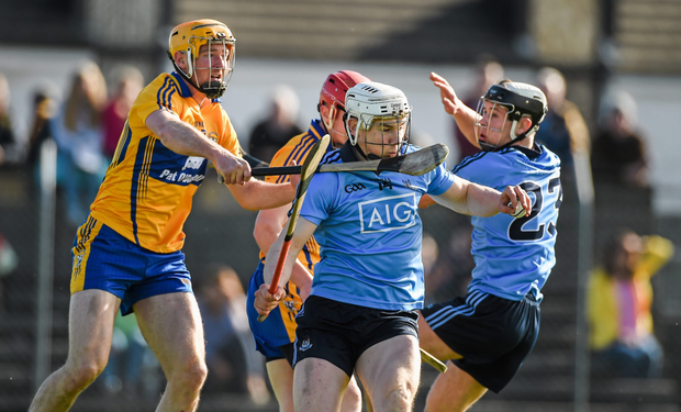 Dublin's Liam Rushe tries to battle his way out of traffic under pressure from Clare's Cian Dillon when the sides met in their Allianz HL Division 1A encounter of March 2015 Picture: Sportsfile