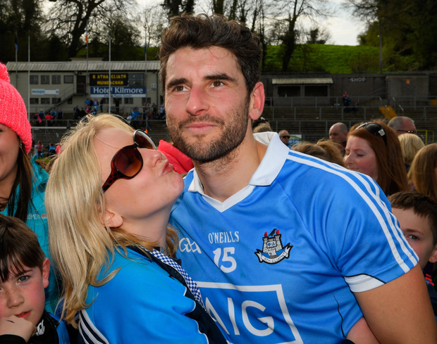Dublin supporter, Laura Curley from Swords, greets Bernard Brogan as he makes his way off the pitch.