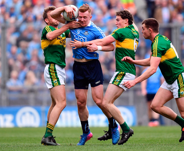 Dublin's Ciaran Reddin is tackled by Kerry's Donnchadh Walsh, left, and Tadhg Morley