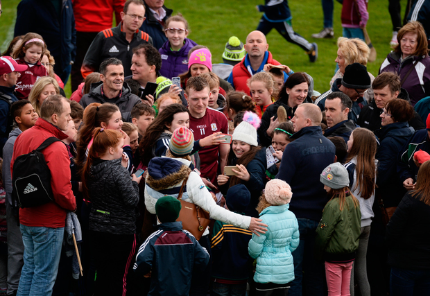 Galway's Joe Canning is swarmed by fans of both counties following last Sunday's Allianz HL Division 1 semi-final victory over Limerick. Pic: Sportsfile