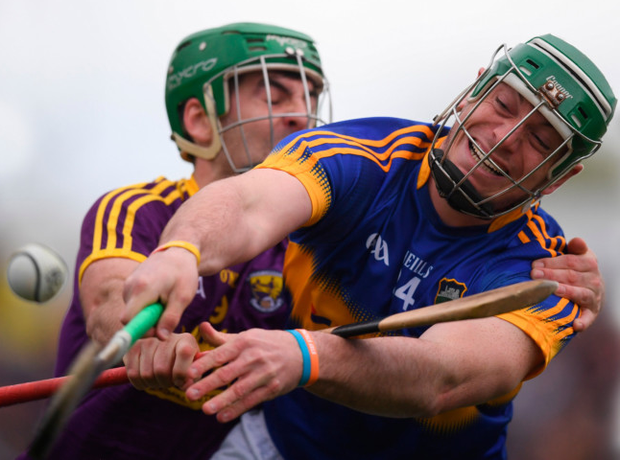 Tipp's John O'Dwyer (right) and Wexford's Shaun Murphy battle for possession during their Allianz HL Division 1 semi-final.