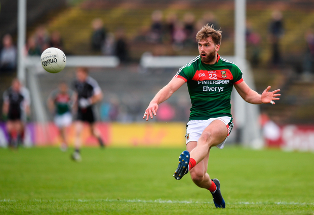 Mayo's Aidan O'Shea drives a pass into his forward line during yesterday's Connacht SFC quarter-final match victory over Sligo at Elvery's MacHale Park, Castlebar. Pic: Stephen McCarthy/Sportsfile