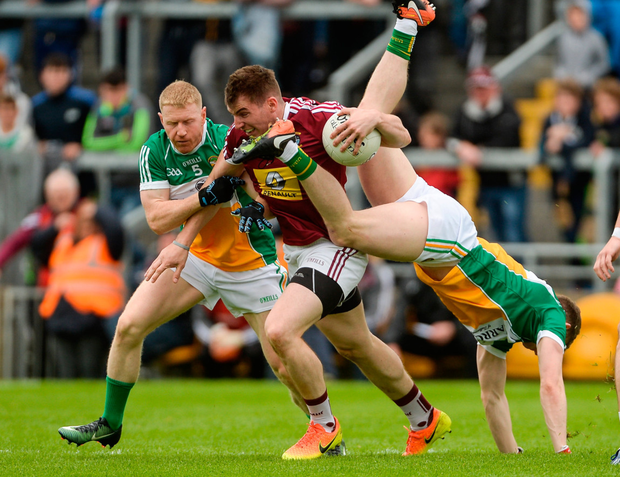 Kieran Martin of Westmeath in action against Seán Pender and Niall Darby, left, of Offaly. Photo: Sportsfile