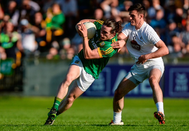 Meath's Cillian O'Sullivan is well marshalled by Kildare's Eoin Doyle. SPORTSFILE