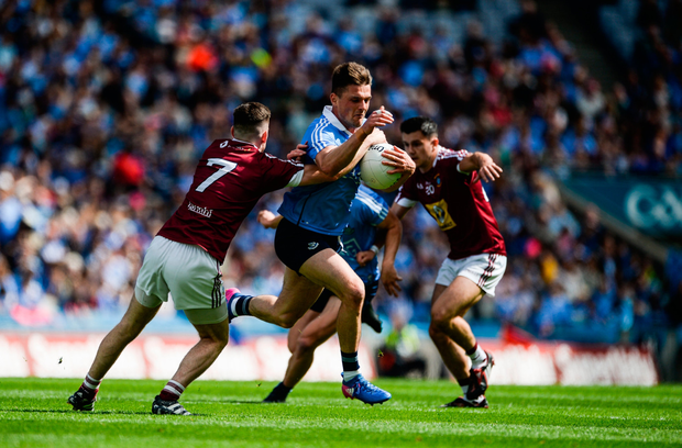Dublin's Eric Lowndes breaks past the challenge of Westmeath's James Dolan. SPORTSFILE