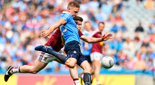 Dublin's Eoghan O'Gara fires to the net despite the efforts of Westmeath's Callum McCormack. SPORTSFILE