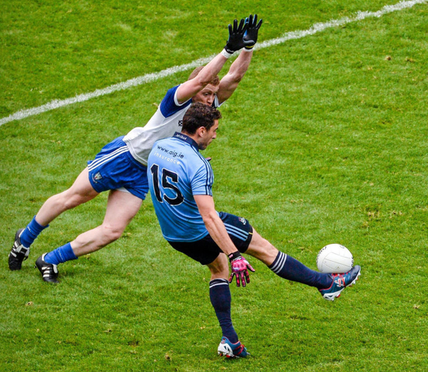 Dublin's Bernard Brogan gets his shot away despite the challenge of Monaghan's Kieran Duffy during the 2014 All-Ireland SFC quarter-final at Croke Park. Photo: Dáire Brennan / Sportsfile