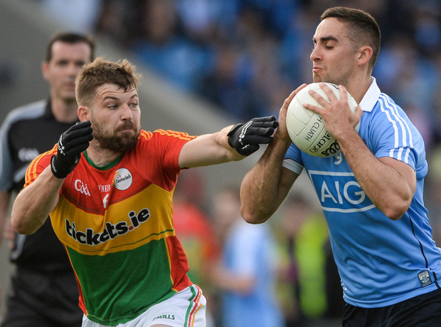 Carlow's Daniel St Ledger puts Dublin's James McCarthy under pressure during their Leinster quarter-final at O'Moore Park