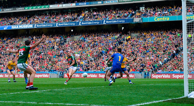 Mayo's Keith Higgins scores his side's third goal against Roscommon in the All-Ireland SFC quarter-final replay at Croke Park. Photo by Ramsey Cardy/Sportsfile