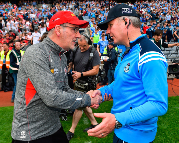Tyrone manager Mickey Harte shakes hands with Dublin counterpart Jim Gavin after the game