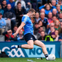 Lee Keegan of Mayo throws a GPS pack in the direction of Dublin's Dean Rock as Rock kicks the winning point from a free during the All-Ireland SFC Final at Croke Park