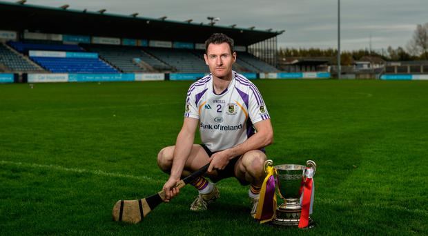Kilmacud Crokes hurler Niall Corcoran with the New Ireland Assurance Company Perpetual Challenge Cup during a Dublin SFC/SHC Finals media day at Parnell Park yesterday. Pic: Piaras Ó Mídheach/Sportsfile