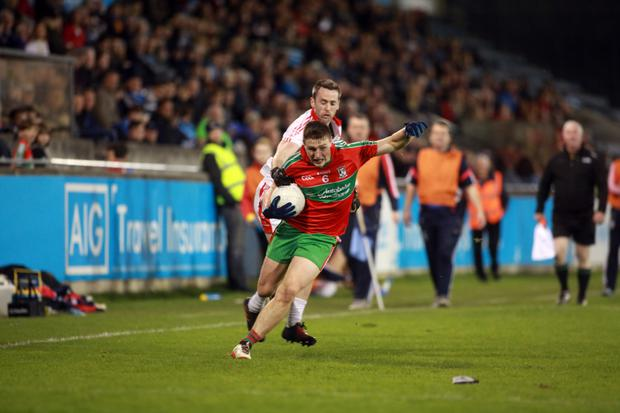 Ballymun Kickhams' John Small holds off St Brigid's Lorcan McCarthy during the Dublin SFC quarter-final at Parnell Park. Pic: Garrett White