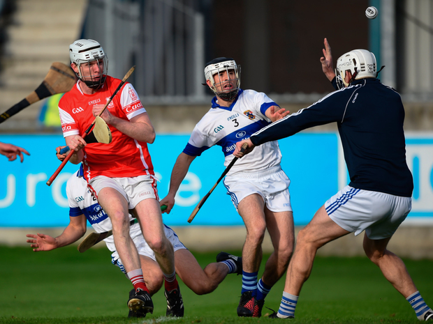 Cuala's Colm Cronin fires to the net under pressure from St Vincent's James Cooke and Ruairi Trainor. Pic: Sportsfile