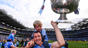 Denis Bastick celebrates with his son Aiden after Dublin's victory over Mayo in this year's All-Ireland SFC final at Croke Park. Pic: Sportsfile