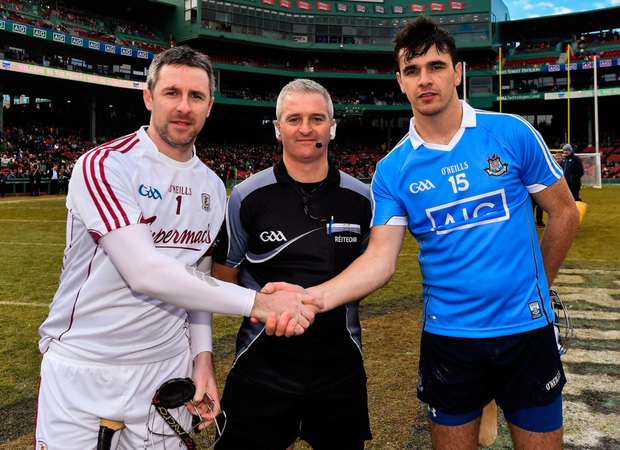 Team captains Colm Callanan of Galway and Danny Sutcliffe of Dublin with referee Johnny Ryan before the AIG Super 11's Fenway Classic Semi-Final match between Dublin and Galway at Fenway Park in Boston. Photo: Sportsfile