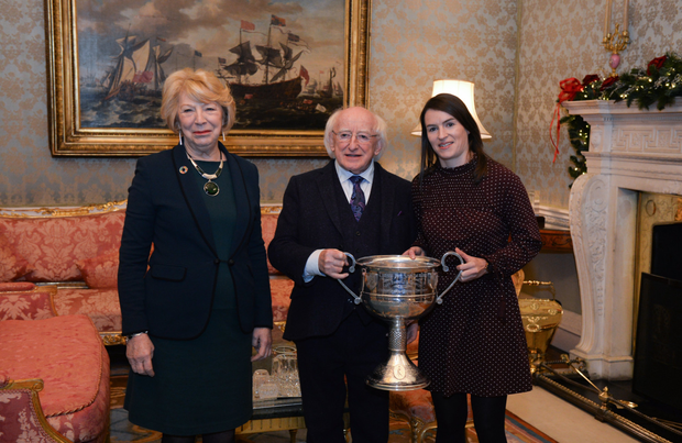 Dublin ladies football captain Sinéad Aherne is welcomed by the President of Ireland Michael D Higgins and his wife Sabina during the Áras an Uachtaráin reception for the Dublin senior men and ladies' squads. Pic: Sportsfile
