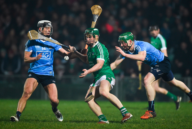 UNDER PRESSURE: Sean Finn of Limerick in action against Cian Boland and Fergal Whitely of Dublin during the Allianz Hurling League Division 1B match at the Gaelic Grounds. Photos: Sportsfile