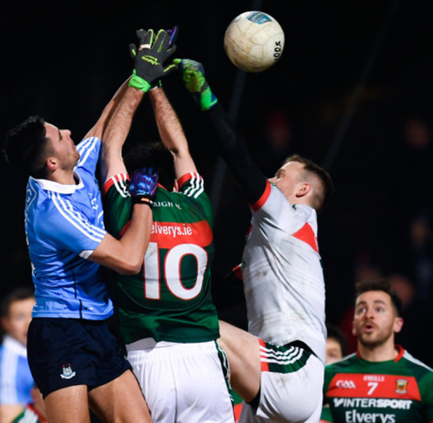 Goal: Dublin's Niall Scully outjumps Mayo's Kevin McLoughlin and keeper Rob Hennelly during last Saturday's night's Allianz FL Division 1 clash at Elverys MacHale Park, Castlebar