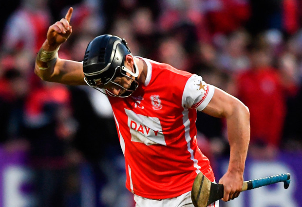 On the mark: Mark Schutte of Cuala celebrates scoring a late point during the AIB Hurling All-Ireland Senior Club Championship Final replay against Na Piarsaigh at O'Moore Park in Portlaoise