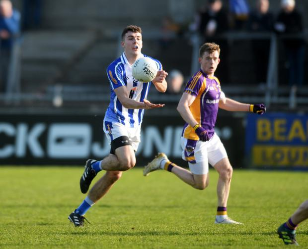 IMPRESSIVE: Ballyboden St Enda's James Madden sets up an attack as Crokes' Cian O'Connor closes in during last Saturday's Dublin SFC Group 1 clash at Parnell Park Pic: Caroline Quinn