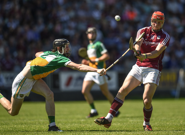 BATTLE: Galway's Conor Whelan gets his shot away under pressure from Offaly's Ben Conneely