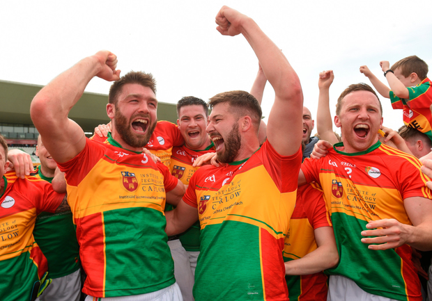 SHOCK: Carlow players celebrate victory over Kildare. Photo: Sportsfile