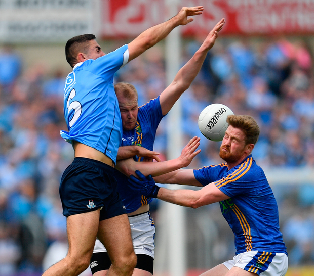POWERHOUSE: James McCarthy in action for Dublin against Theo Smyth and Kevin Murphy of Wicklow on Sunday. Photo: Sportsfile