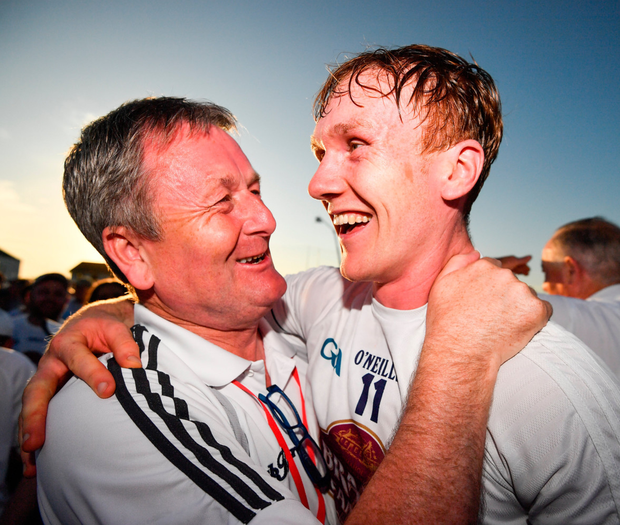 JUSTIFIED: Paul Cribbin of Kildare is congratulated by Marty McEvoy, Chairman of the Kildare Supporters Club, following the Football Qualifier victory over Mayo at St Conleth's Park. Photo: Sportsfile