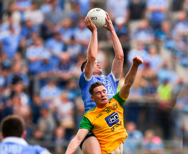 MAJESTIC: Dublin's Brian Fenton outfields Donegal's Caolan Ward Pics: Sportsfile