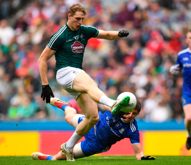 DAN DARE: Kildare's Daniel Flynn scores his early goal, despite the efforts of Monaghan's Darren Hughes, in yesterday's All-Ireland SFC quarter-final Group 1 Phase 1 clash at Croke Park