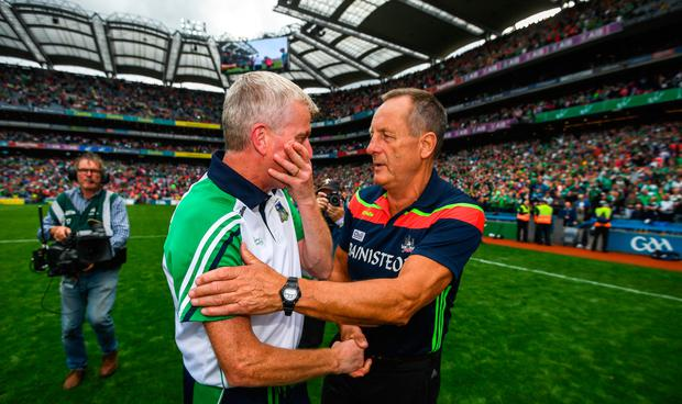 Limerick manager John Kiely and Cork manager John Meyler after the game. Photo: SPORTSFILE