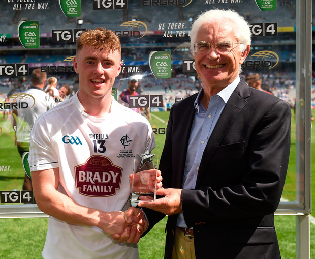 IMPRESSIVE: Kildare forward Jimmy Hyland is presented with his EirGrid Man of the Match award by John O'Connor, Chairman of EirGrid. Pic: Sportsfile