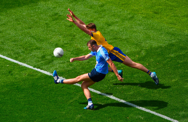 IN-FORM: Dublin's Cormac Costello kicks a point despite the attempted block of Roscommon's Niall McInerney in Sunday's All-Ireland SFC quarter-final Group 2 clash at Croke Park. Photo: SPORTSFILE