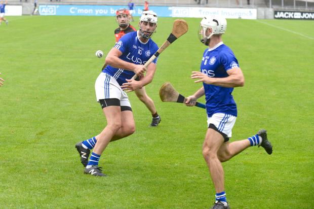 Crumlin's Shane Ryan flicks the sliotar to Lee Coleman. Photo: Justin Farrelly